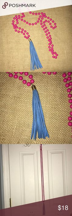 Pink beaded necklace with blue tassel Handmade pink beaded necklace with blue tassel. Can be worn as a long necklace or wrapped twice (as seen in last photo.) Perfect for spring and summer to add a pop of color to your look! Measures 28 inches (unwrapped) Jewelry Necklaces