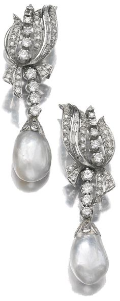 Natural pearl and diamond earclips, 1950's. Each suspending a natural pearl drop, the surmounts set with circular-, single-cut and baguette diamonds. Via Sotheby's.