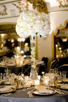 White hydrangea, roses, cymbidium orchids, and hanging crystals. Classic Wedding Style Ideas and Inspiration