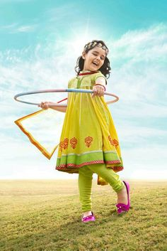 Give summer a zesty twist with this lemon yellow kalidar kurta with brocade yoke & a bright floral block printing at hemline. Makes for a perfect attire with churidar & a dupatta. Frocks For Girls, Dresses Kids Girl, Baby Dresses, Pakistani Kids Dresses, Dance Outfits, Girl Outfits, Kids Party Wear, Kids Ethnic Wear, Kids Suits