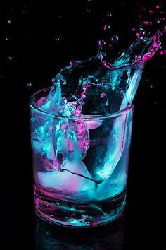 Turquoise & purple | glow-in-the-dark liquid splashing in a glass