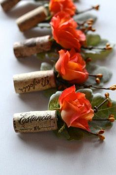 Boutonnieres pin them by gluing brooch pin to the back of the cork.