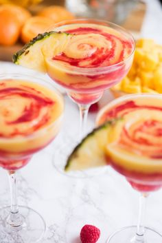 These raspberry swirl pineapple mango margaritas are the best frozen cocktail you've ever had! Visit The Sweetest Occasion for this cocktail recipe and loads of entertaining tips, party ideas and more! Frozen Strawberry Margarita, Frozen Margaritas, Frozen Cocktails, Summer Cocktails, Lime Margarita Recipe, Peach Margarita, Frozen Margarita Recipes, Alcohol Drink Recipes, Yummy Drinks