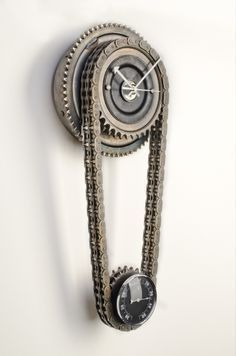 """Our """"Fat Gear"""" wall clock is a true beauty to anyone that enjoys upcycled designs. Created from original American motorcycle parts, graced by original patina,  this wall clock looks just stunning. The heavy primary chain holds a thermometer to indicate when its time to get your butt on the bike and ride in great weather. We ship worldwide."""