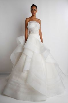 I love the placement of the fabric on this dress. It flows and the bodice looks like a flower but it isn't too much and overtakes the attention form the person wearing it. #weddingdress