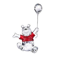 A charming Winnie the Pooh crystal figurine holding a balloon from the Swarovski Disney range. Fun and collectible, an ideal gift or a treat for yourself.  Swarovski - Winnie The Pooh Disney Figurine