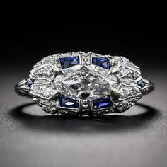 S: Soo pretty! I would for sure rock this!  .58 Marquise-Cut Diamond and Sapphire Art Deco Ring - 10-1-6778 - Lang Antiques