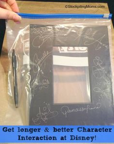 Signing a photo frame instead of an autograph book. Good idea, how to keep from getting messed up while running around the parks??