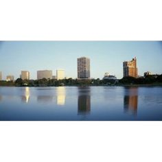 Reflection of skyscrapers in a lake Lake Merritt Oakland California USA Canvas Art - Panoramic Images (24 x 12)