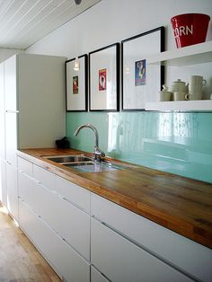 wood, white and turquoise kitchen - I feel like I could fake this in our rental kitchen with pale turquoise wall paint.