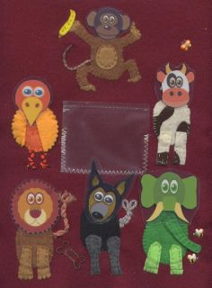 Mixed-up animal quiet book page: Each of the animal's heads is detachable and can be stored in the pouch or moved around to different bodies.