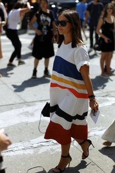 Fashion Week is here and despite ninety degree temperatures, the super chiccrowds came out in droves. As captured by our intrepid street style photographer, Hanuk, models, editors, bloggers and, oh by the way, Lauren Hutton, provedthatthe most covetable looks of the season are not always on the runway. From crisp whites to bold stripes and mixed prints, we found a lot to lust after. So, go ahead, flip through the slideshow for cues from a few of our favorite influencers.