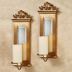 With a beautiful framed design and a gold finish, the Acanthus Mirrored Wall Sconce Set complements your decor with a stately traditional flourish.