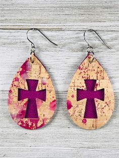 This is a pair of tear drop earrings in leather and cork. The earrings are doubled layered with the top layer in natural cork and the bottom layer in magenta. A magenta cross is seen through the cutout. Diy Leather Earrings, Diy Earrings, Leather Jewelry, Statement Earrings, Cross Earrings, Ruby Jewelry, Jewelry Findings, Women Jewelry, Custom Jewelry