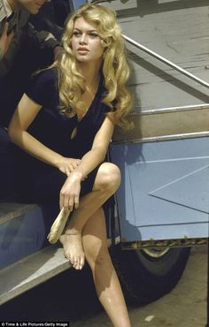Smoking hot: Brigitte Bardot on set during filming of Lady and the Puppet