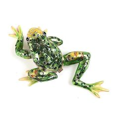 """Stretching Frog Trinket Box Item No. KB00475A01 $33.59 This frog stretches out to about 4 1/2"" long. The textured and crystal-studded frog opens up to reveal a convenient area to store jewelry or other small items. The interior is a blue-green hue that matches many of the Austrian crystals seen on the outside. This well-made trinket box has been gold plated and fixed with a hinge and magnet."" Frog Stretch, Cute Frogs, Family Jewels, Austrian Crystal, Trinket Boxes, Blue Green, Stretching, Crystals, Hue"