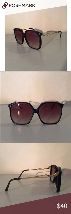 Vintage 1970s Opti-Ray Sunglasses Vintage 1970's large framed sunglasses. Small mark on the side of left frame (as seen in photo). Some stretching on the arms, but still wearable. Vintage Accessories Sunglasses