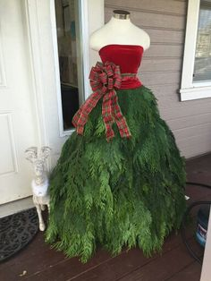 Christmas Dress Form for the front porch made from tree clippings.