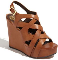 """The Vince Camuto 'Shivona Sandal' with logo embossed hardware... Every staple wardrobe needs a good wedge. This fudge brown color is gorgeous. With a 4"""" high heel and a 1 1/2"""" platform, these are comparable to wearing a 2 1/2"""" heel. Very comfy and feminine. You know your legs are going to look AWESOME in these."""