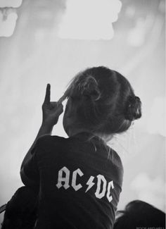 Rock on, little girl whose parents have awesome taste in music.