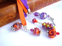 Bookmarks in delightful colours, handmade lapworked beads Follow me at: http://www.facebook.com/Theresesmykker