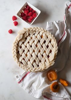 Beautiful lattice apricot-raspberry pie with leaf accents.