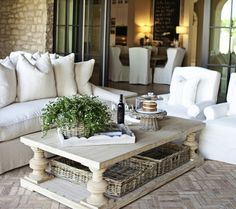 charming.  Love it all: floor, black doors, baskets, coffee table, slipcovered covered furniture