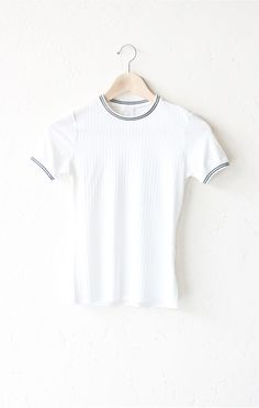 - Description - Size Guide Details: Short sleeve top in white with black & white contrast striped trim collar & sleeve bands. Form fitting, tend to run on the smaller side & are more fitted. 95% Polye