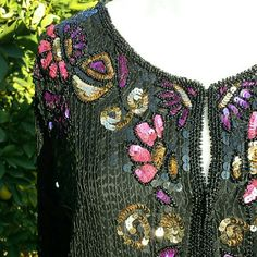 "VINTAGE Sequined Silk Cardigan/Jacket Jean for Joseph Le Bon Sequined Silk Cardigan/Jacket   Exquisite in excellent condition! Made in India. Hook and eye closure, sequined and beaded in black and gold with pink and purple flowers. Pure silk lining. Pit to pit: 20"" Length: 25"" Sleeve length: 23"" Vintage Sweaters Cardigans"