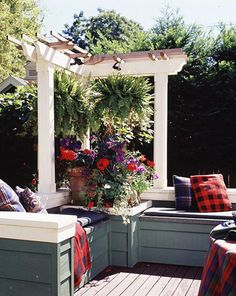 Small space pergola with plant hangers.