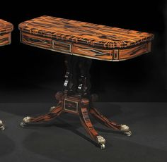 """Pair of Regency Brass Inlaid Calamander Card Tables   1stdibs   Attributed to George Oakley, each with a hinged swiveling D-shaped top opening to a baize-lined surface above a brass-inlaid paneled frieze raised on lyre-form supports on a plinth and down-swept legs ending in brass caps and casters   c.1815, England   36""""w x 17.5""""d x 29""""h each   $58,000.00 USD"""