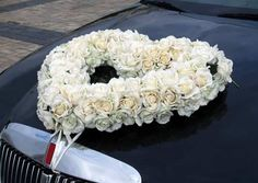A heart of roses adorning the wedding car.