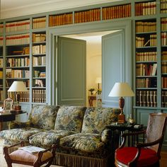 Bookcase with french doors to close off the living room and dining room. Turn the living room into a library.
