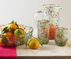 """how off their sunny attitude and delicious succulence in our playful, recycled """"confetti""""""""glassware. Viva Terra"""