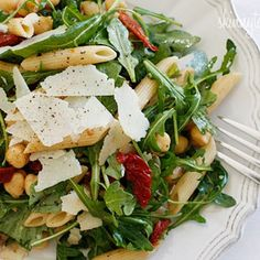 Peppery arugula tossed with nutty chick peas, pasta, sun dried tomatoes, shaved parmesan and balsamic vinegar create a simple yet delicious main dish salad – perfect for lunch or dinner.