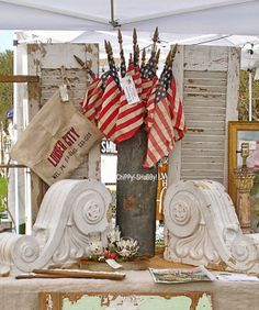 nice display of old chippy shutters, corbels, zinc container and flags! Fourth Of July Decor, 4th Of July, Patriotic Decorations, Patriotic Wreath, Patriotic Party, Le Shop, Vintage Display, Vintage Decor, I Love America