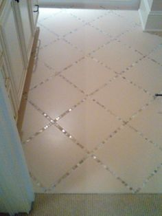 """Lay a thin strip of """"backsplash"""" tile in between the large tiles, instead of just using grout. pretty!"""