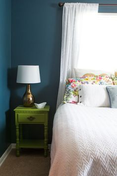 Bright painted night stand and deep teal walls in this simple guest room Bedroom Ideas #Sleepys