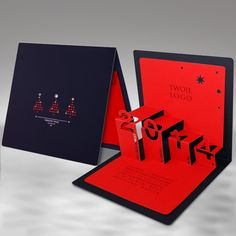 The Christmas card is made of high quality dark blue paper. The dark blue cover has hot stamp silver foil decorative elements. The red insert gives a 3D effect in a shape of the year 2014. The envelope is included.
