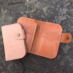 Our #SnapWallet shown here in both #Natural and #Whiskey leather. Features six card slots two interior pockets and snap closure. #MadeInAmerica #QualityGoods