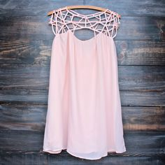 Gorgeous flowy blush chiffon dress that features a caged upper design and a loose fit that drapes down. Fully lined. - Imported. - Polyester - nude blush - relaxed fit small medium large bust 34 36 38