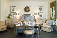 With two matching antique dressers, identical metallic lamps and symmetrical seashell prints, this room feels just right for those who want their room to match -- but not too much. A mirrored-desk and lucite chair at the foot of the bed adds a modern flourish and is glamorous without being too girly.