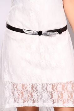 When asked if you ever get tired of sporting outfits that are so intricately styled, your answer is, Certainly not! You would never trade an afternoon of wearing the smooth slim and slender faux leather, front wing buckle belt for a day of simple dressing. This accessory features a unique textured metal wide spread winged snap lock closure centered by a large sparkly rhinestone.