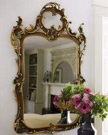 18th century Tuscan style carved wood mirror with hand-painted medium brown finish and antique gold leaf trim