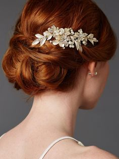 10 elegant hair accessories for your formal wedding | This gold hair comb is adorned with enamel leaves and handmade pearl and crystal flowers, making it perfect for the bride whose wedding is all about the floral decorations.
