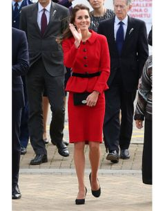 The Duchess took to the cricket field in a lipstick-red Luisa Spagnoli dress with a matching peplum jacket. Black pumps completed the prim look.