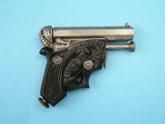 """Delvigne 1835 """"dog and mouse"""" pocket pistol Manufactured by Lepage frères, Paris .32 cap and ball ebonite grip, single shot"""