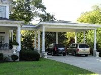 Attached carport with covered walkway to back door