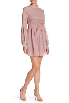 A romantic dress with a lovely lace insert cut with a flattering fit-and-flare silhouette