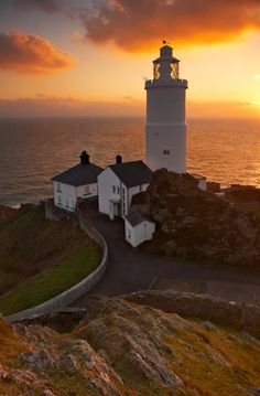 Dawn rises over Start Point Lighthouse...South Devon, UK             by Chris Shepherd